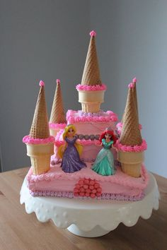 Throwing a Disney Princess party without spending weeks in the kitchen. Planning a Disney Princess party doesn't have to be as painful as kissing a frog. We have everything you need in one place to throw a Disney Princess party. Disney Princess Birthday Party, Disney Princess Party, Birthday Cake Girls, Princess Castle, Princess Cakes, 4th Birthday, Birthday Ideas, Birthday Crowns, Princess Party Cupcakes