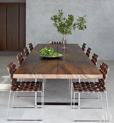 Mara wood custom Tucker Robbins dining table with woven leather dining chairs