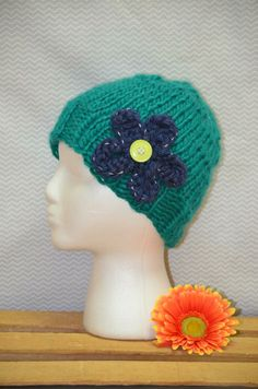 colors: teal/navy style: fitted with flower size: adult