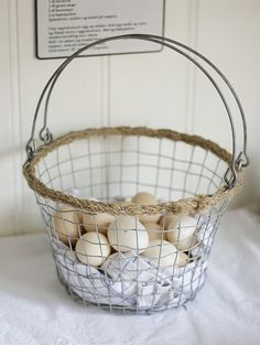 Eggs in wire basket.