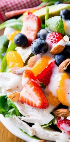 Strawberry Almond Chicken Salad - full of juicy berries, crunchy almonds, creamy avocado, chicken, and topped with homemade poppy seed dressing. Gluten free recipe!