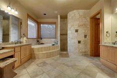 Mediterranean Master Bathroom with Simple Granite, Simple granite counters, Raised panel, Master bathroom, High ceiling