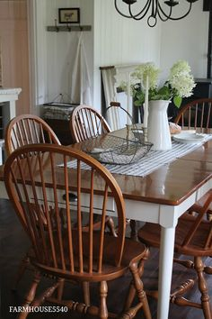 Farmhouse table, bead board walls, spindle legged Windsor chairs, striped linen runner, ironstone pitcher full of garden blooms