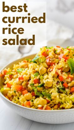 This quick and easy rice salad recipe is great for summer cookouts and potlucks. Loaded with fresh veggies like bell peppers, green onions and garbanzo beans, it's the homemade curry dressing that makes this vegetarian, gluten free side dish special. The honey dijon vinaigrette with turmeric, curry powder and fresh herbs like parsley and mint is lip smacking good. #ricesalad #sidedish Healthy Salad Recipes, Veggie Recipes, Pasta Recipes, Vegetarian Recipes, Rice Salad, Soup And Salad, Healthy Side Dishes, Side Dish Recipes, Best Curry