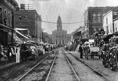 """A view of the courthouse in the early 1900s in Downtown Fort Worth. This was taken at the """"Flower Parade and Festival"""". (From Facebook, Visit Fort Worth)"""