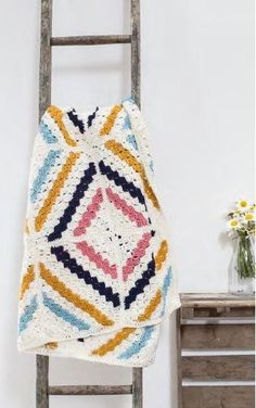YOU WILL ALSO NEED • A 4mm (UK 8 / US G/6) crochet hook • A tapestry needle TENSION 1 square measures 22cm NOTE The blanket is constructed out of blocks of 4 squares. The size of the blanket is easily adjusted by adding more squares as required