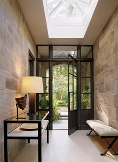 Tiled walls, glass doors and skylight