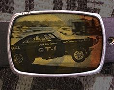 Hot Rod Belt Buckle. We use a one-of-a-kind process to bring you these awesome belt buckles. During the printing process each image is coated with an extra thick layer of urethane to seal and protect the image for a lifetime. This urethane also brings the image to life and highlights all of the color, and details. Our process produces a belt buckle that you will be able to enjoy for years to come. (I still wear one that we made 10 years ago and it looks brand new!) The listing is for the...