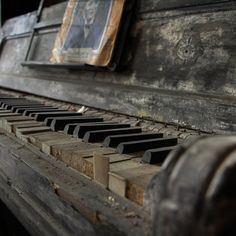 faded glory . . . I'm always drawn to the decaying pianos in op shops. Adorned with European manufacturers' names in extravagant gilded script, it's hard to imagine a sadder contrast than the then-and-now of a decaying piano.