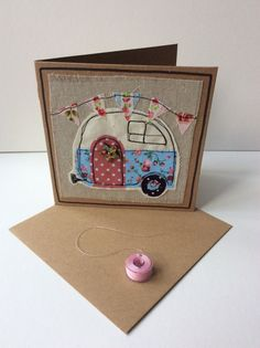 Hand made raw edge applique card with free motion embroidery for a sketched effect.