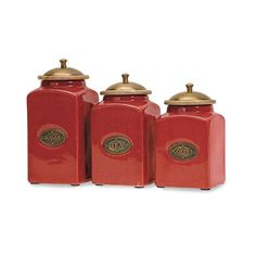 The vivid red finish of this ceramic canister set gives it a bright and cheery look. Each canister has a wood lid and features its own content label. Food safe.