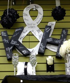 "A really great (and easy!) way to add a personal touch to your wedding: Instead of a guest book have your guests sign your initials and a ""&"" sign - not only a fun piece to have on your wedding day, but a great piece to then display in your home!"
