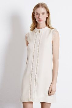 This sleeveless dress features a peak collar, shift cut, lace inserts and zip and hook fastening at the back; fully lined. Length of dress, from shoulder seam to hem, 85cm approx. Height of model shown: 5ft 10 inches/178cm. Model wears: UK size 10.