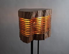 ILLUMINATED SCULPTURE This illuminated sculpture reveals the elemental form and grain in a piece of reclaimed California Incense Cedar. Fascinating details and hidden beauty are revealed from light emitting from the center of the sculpture, flowing out between each individual slice suspended on an aluminum armature. The warm light traces the contours of the wood capturing beautiful patterns from all angles. THIS PIECE Every piece of wood is unique however some are more remarkable than…