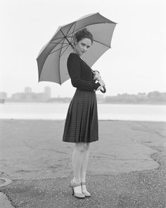 Zooey Deschanel. look great in a vintage outfit by delicately holding an umbrella.