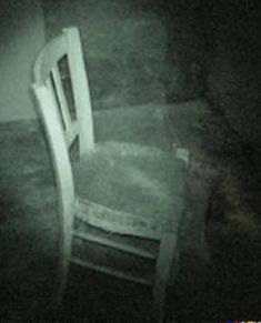 This pic looks like it was taken on an investigation somewhere or possibly a still from a night vision camera. Can you see anything on the chair? You decide HBI Haunted Britain Investigations - it looks like a little child sitting on the chair! Ghost Pictures, Creepy Pictures, Ghost Pics, Ghost Images, Spooky Places, Haunted Places, Haunted Houses, Paranormal Pictures, La Danse Macabre