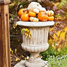 Arrange pumpkins of all shapes and sizes to make a festive fall display. More fall decorating: http://www.bhg.com/halloween/outdoor-decorations/fall-outdoor-decorating-from-halloween-to-thanksgiving/?socsrc=bhgpin090513pumpkinplanter