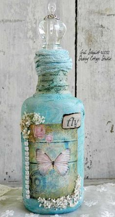 Decorate a Bottle~ vintage style with lace, scrapbook paper, old keys and charms too!