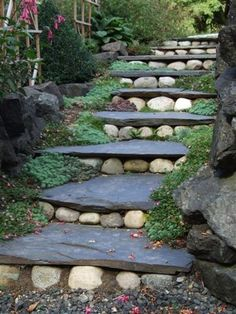 Slate steps with river rocks in a garden - incorporating found objects with…