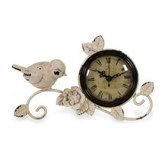 Features:  -Bird tabletop clock.  -Clock rose design.  -100% Iron construction.  -Antique white finish.  -Electric clock requires one AA battery.  Product Type: -Tabletop.  Time Display: -Analog. Dime