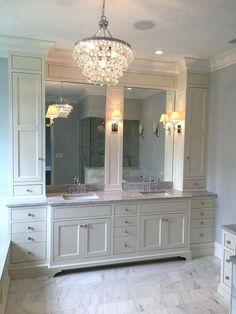 10 bathroom vanity design ideas that can help narrow your choices for your space. This off white vanity offers a ton of storage space and pairs well with an elegant lighting fixture. Bad Inspiration, Bathroom Inspiration, Mirror Inspiration, Bathroom Vanity Designs, Bathroom Ideas, Budget Bathroom, Dorm Bathroom, Bath Ideas, Bathroom Pictures