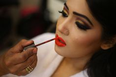 Red lips always lie :D Bride in the making! To see more of her: http://www.functionmania.com/blog/truestory-dreamy-wedding-anjali-divey/