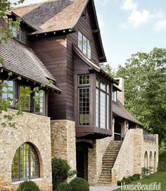 The rear façade features a staircase of Tennessee fieldstone that leads to a covered porch with an outdoor fireplace in a western North Carolina house. Click through for more of the most beautiful home exteriors and home exterior design ideas. Architecture Renovation, Residential Architecture, Architecture Details, Staircase Architecture, Villa, D House, Mountain Homes, Mountain Home Exterior, Mountain Cottage
