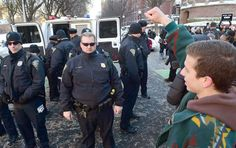 New Haven Police arrested demonstrators who blocked the intersection of Elm and College Streets in New Haven, Conn., Friday, Feb. 10, 2017 and refused to move during a protest and demonstration in favor of changing the name of Yale University's Calhoun College. The peaceful arrests were pre-planned and coordinated between the demonstrators and New Haven Police. (Peter Hvizdak/New Haven Register via AP) Photo: Peter Hvizdak, AP / ©2017 Peter Hvizdak