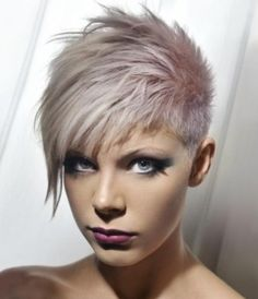Grey crop cut with long side swept piecey bangs hairstyle
