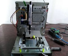 this a mini CNC 2D plotter made from old DVD drive and L293D motor shield very cheap but intrestinglet see how to make in