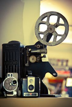 Vintage Film Projector, I miss the sound of the projector at movie theaters. I also miss the imperfections on the screen.