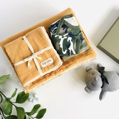 A little soldier is born… * 4-layer 100% cotton muslin breathable blanket set in Honeycomb with a contrast cream lace trim. Measures large 130x130cm/ Small 60x50cm. * All over camo print 100% cotton pull on baby romper with popper leg opening. * Soft cotton knit plush bear in grey with dark grey ribbon neck tie. 16cm from sitting. * All orders arrive beautifully gift wrapped in our Deluxe gift box (35x25x10cm). Re-use as a keepsake box. Muslin Blanket Set 4 layers of 100% cotton muslin… Baby Gift Sets, New Baby Gifts, Baby Gift Hampers, Grey Ribbon, Muslin Blankets, Cotton Muslin, Baby Arrival, Newborn Baby Gifts, Camo Print