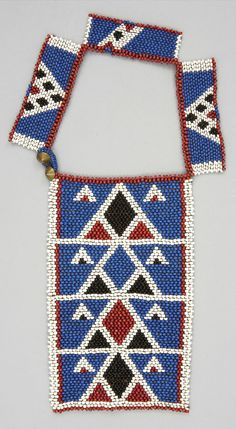 South Africa | Necklace (ulimi) from the Zulu people; glass beads, plant fiber and brass buttons | ca. 1870 - 1929