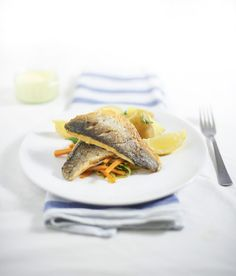 A recipe for pan-fried sea bass with buttery leeks and carrots, and mustard mayonnaise. Photographed by Thomas Baker Photography.