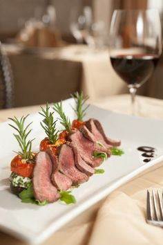 7. Grilled lamb loin with roasted tomatoes and goat cheese-stuffed mushrooms