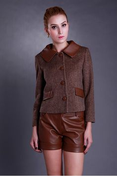 Cropped coat crafted in wool blend fabric, featuring, long sleeves, big turndown collar, twin front pockets, contrast panel of PU to collar and pocket flaps, leather look button through front fastening and seams detail.$116