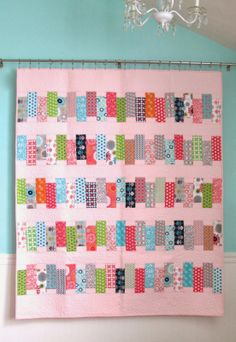 I love the way this quilt is displayed. Very easy to change out for variety.