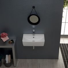 With of length, this wall mounted or vessel styled sink is made out of beautiful ceramic with a white finish. With a single faucet hole and an included overflow, this model provides a luxurious addition to any modern bathroom. Space Saving Bathroom, Small Bathroom Sinks, Modern Bathroom, Powder Room, White Ceramics, Wall Mount, Faucet, Cabin, Model