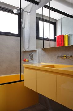 Impressive interior project design of DM House in São Paulo, Brazil, comes from the drawing board of interior designers from Studio Guilherme Torres. Bathroom Kids, Laundry In Bathroom, Modern Bathroom, Yellow Cabinets, Concrete Bathroom, Yellow Bathrooms, Bathroom Pictures, Bathroom Interior Design, Bathroom Inspiration