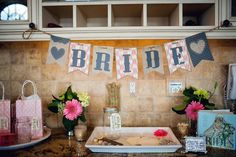 "Bride table for personal wedding shower: raffle for guests, ""wish jar"" for bride, and frame to sign (we will fill with a picture of shower later):  http://www.sarahrobbins.com/bridal-shower-by-katie-farrell-of-dashing-dish-and-sarah-robbins-of-team-rockin-robbins/"