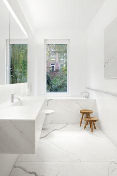 nice floating sink and toilet to create more floor space; nice window