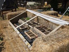 One of the nicest incarnations of a straw bale cold frame I've ever seen. Simple & effective!