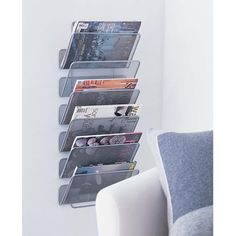 #214 wall mounted magazine rack - perfect for storing textbooks and homework by subject