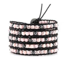 This bracelet features pink turquoise (howlite) and hematite handwoven onto black leather. Bracelet includes an engraved Katie Joëlle clasp and wraps around the wrist five times with three adjustable