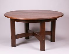 Gustav Stickley massive fixed-top dining table with raised-arch cross-stretchers c1903-1905. Signed with partial paper label. Refinished. 54″d x 30″h