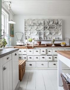 Light airy room, but oh that long counter with all those drawers and those handles.