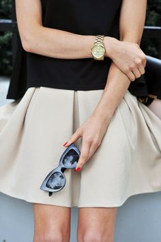 off white/light khaki/gray skirt & black sweater.. skirt good length not too long, not too short.. just above the knee
