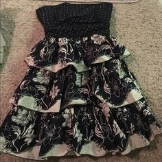 FOREVER 21 polka dot and floral tiered dress Super cute and flirty Ruffles cotton strapless dress. Hidden side zipper and tie back sash bow. Versatile for all your summer events. Can be dressed up or down. Forever 21 Dresses