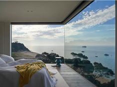 Huge windows with stunning ocean view in a contemporary bedroom.