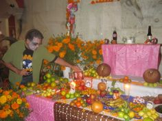 Placing a photo of my great-grandparents on the hotel's Day of the Dead altar. www.johnkachuba.com